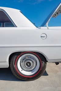 rear end of a white car from the 1950s
