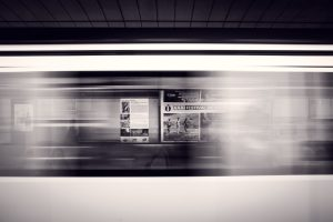 image fast moving train from the sde view, black and white photo
