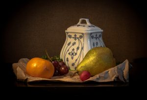 Still Life Photograph classical style with pot and fruit - pear and tangerine on a table cloth